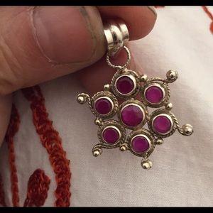 Steel ruby pendant
